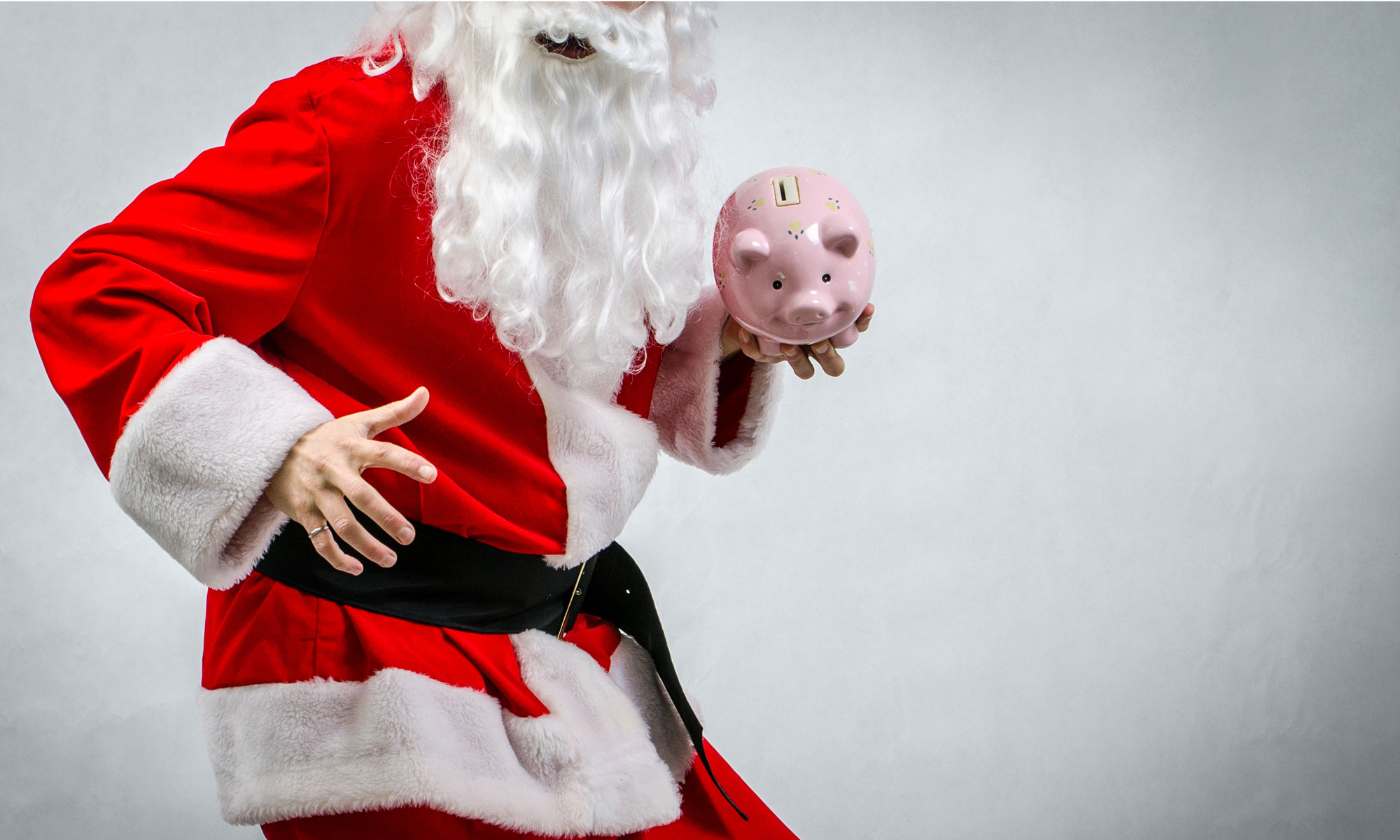 Santa holding a piggy bank