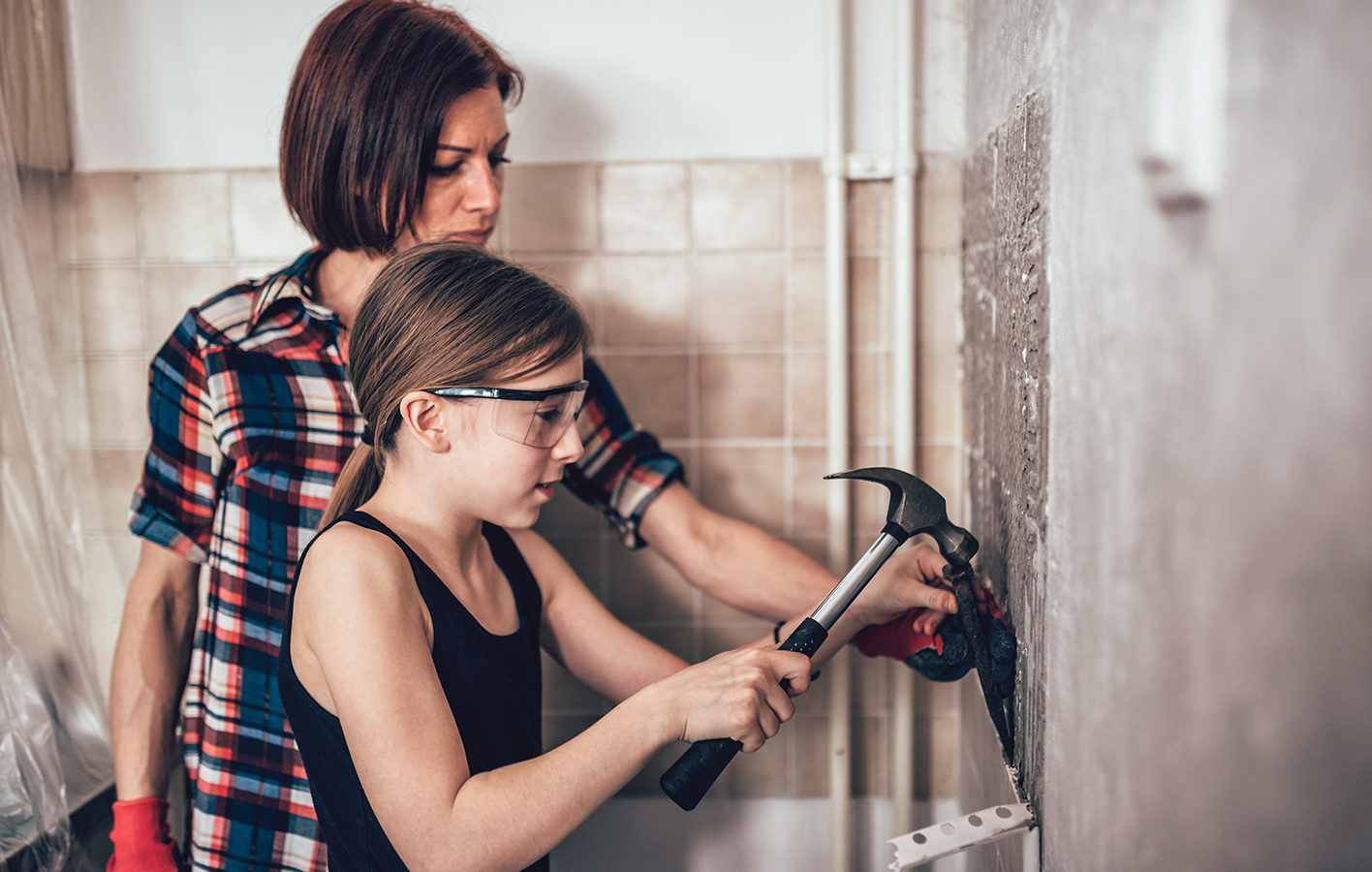 Mother and daughter working with tile
