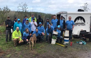 Team WECU posing for a photo in their blue shirts