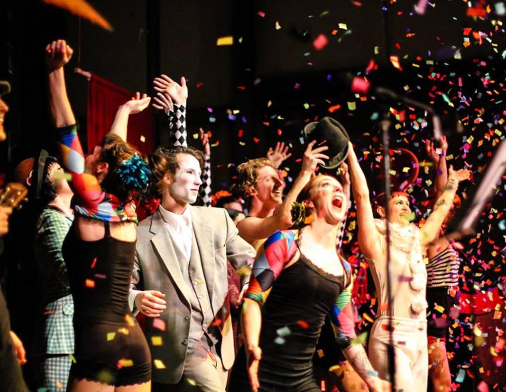 The Bellingham Circus Guild cheering as confetti flies through the air.