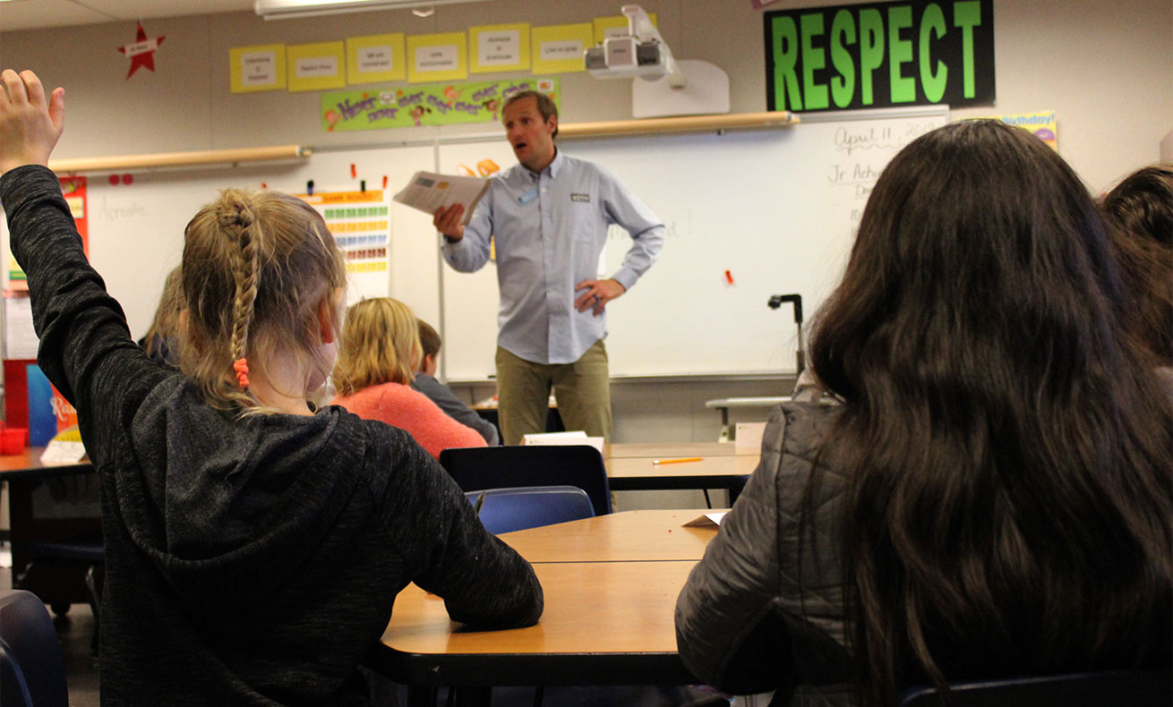Reid Frederick talking to a group of students in a classroom.