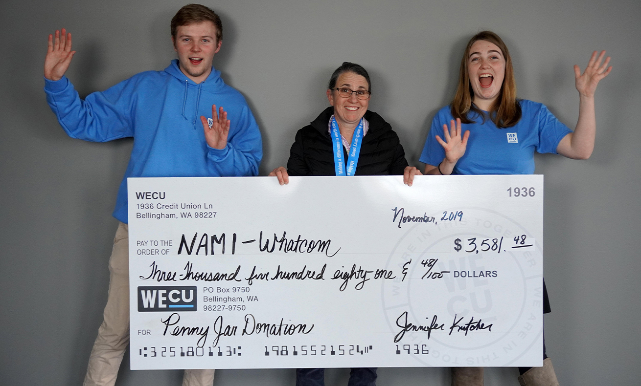 WECU presents a check for $3,581.48 to NAMI Whatcom.