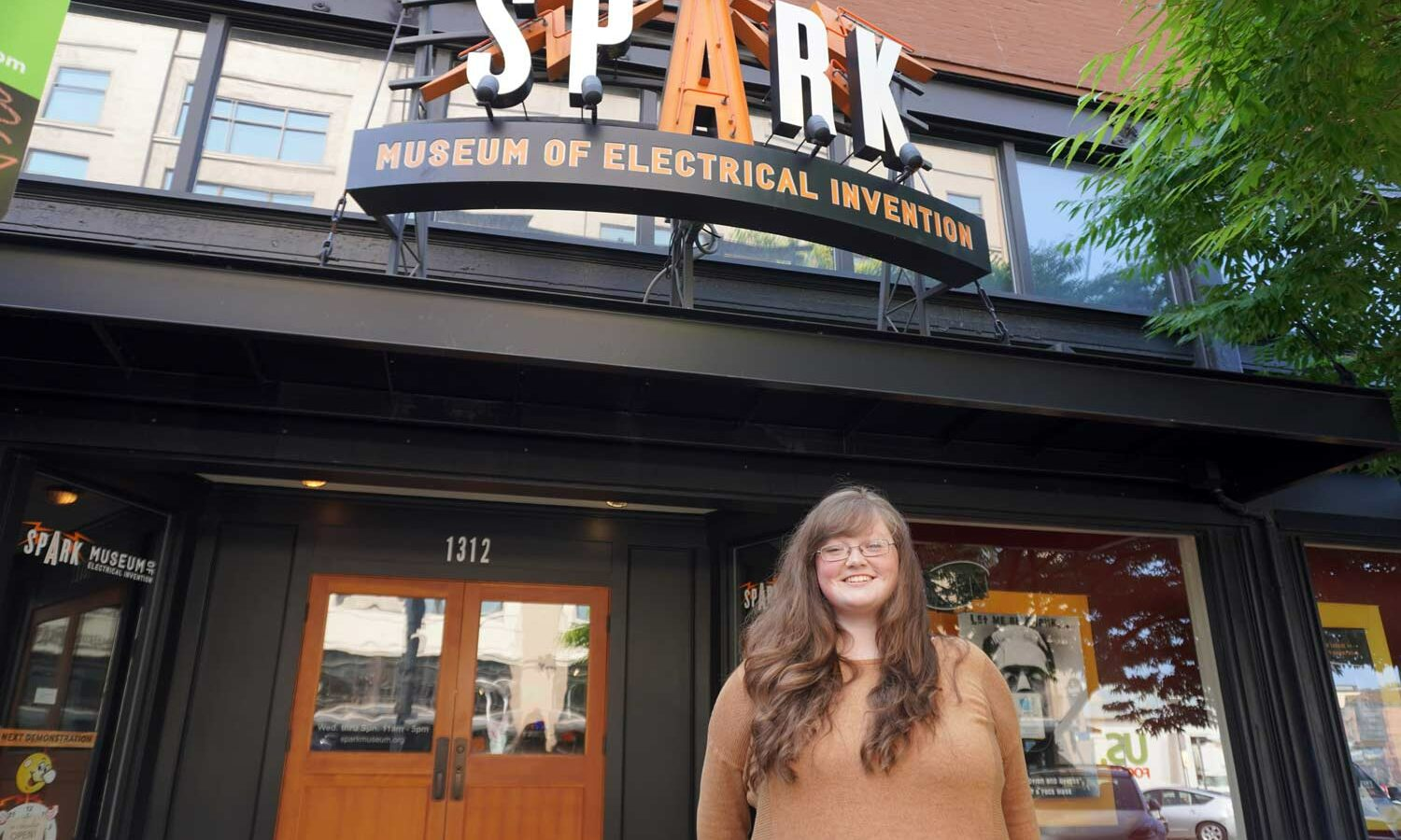 Abby Whatley, director of programs, stands in front of the spark museum.
