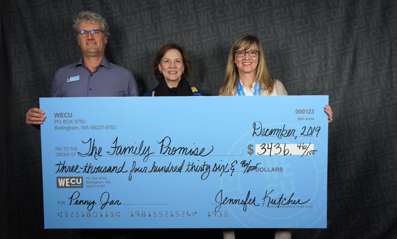 Representatives from The Family Promise pose for a photo with a check for $3,436.46.