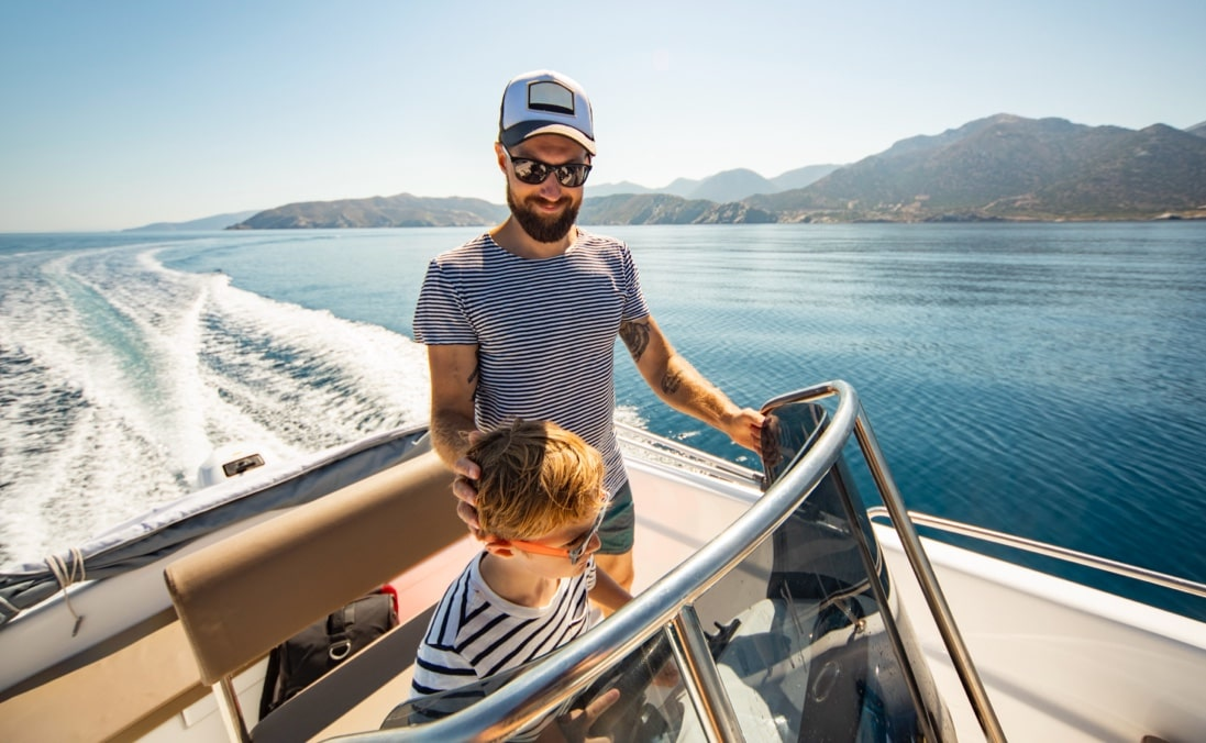 Father and son on a boat