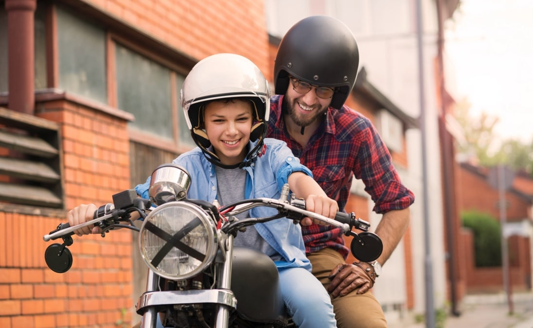 Father and son on a motorcycle