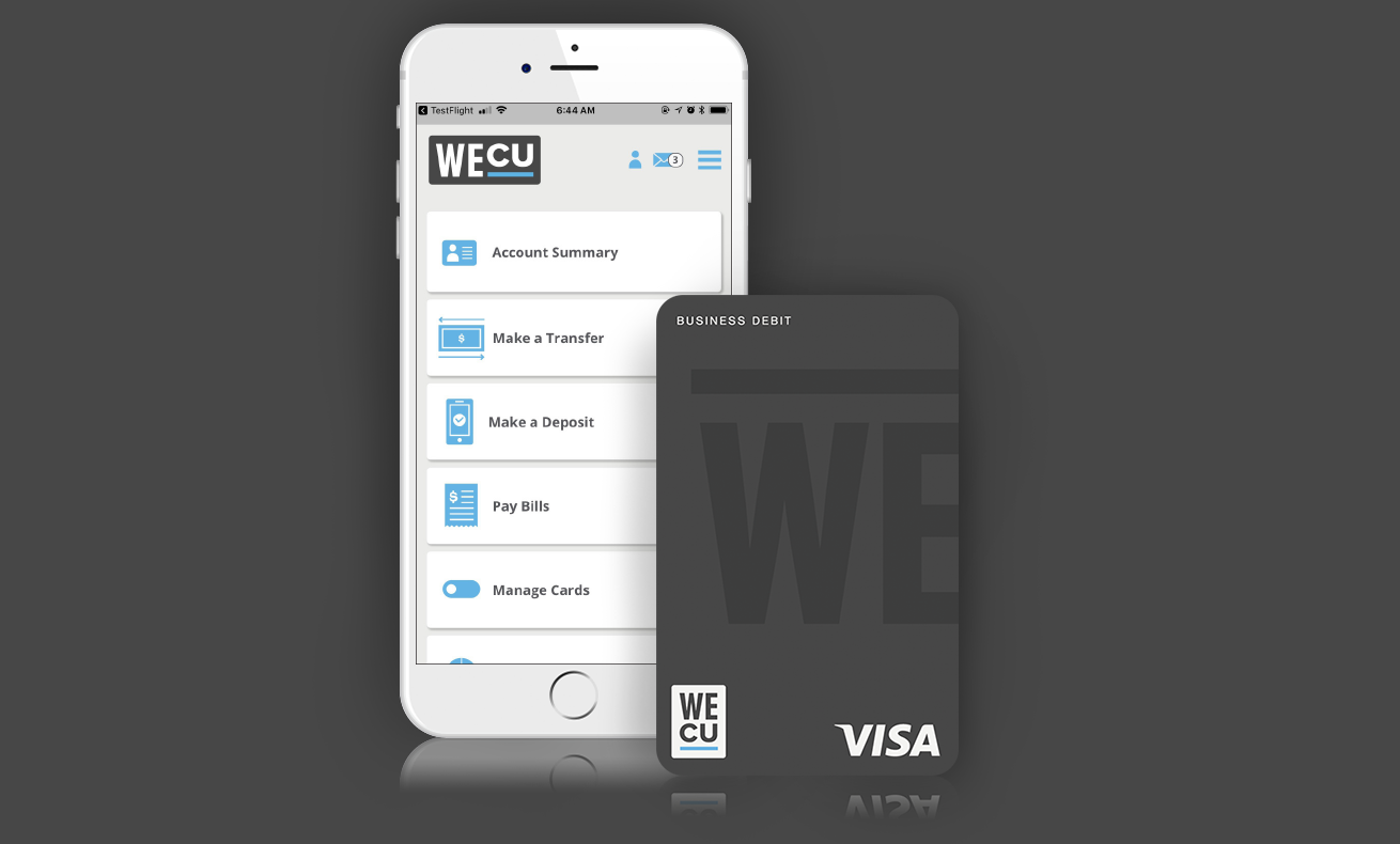 The WECU business debit card next to a phone displaying the WECU mobile app.