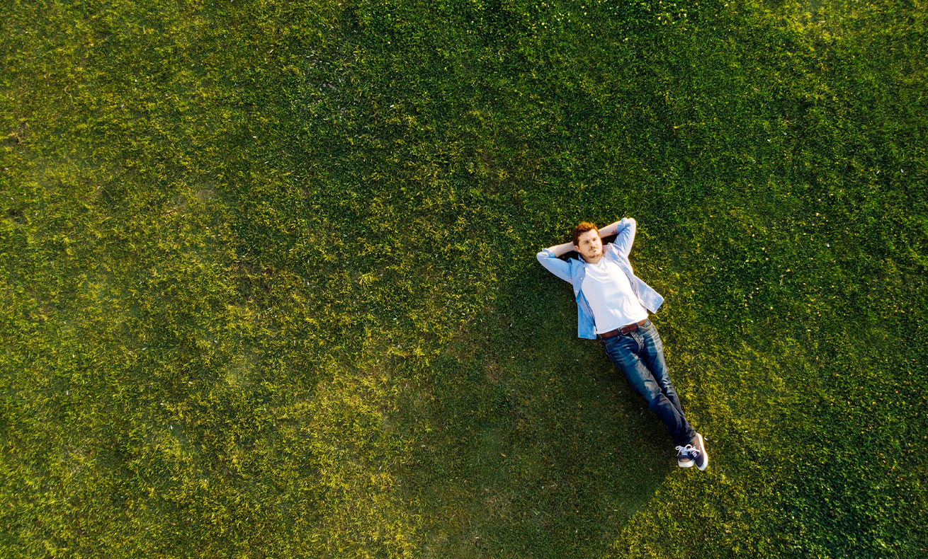 Man relaxing on the grass.