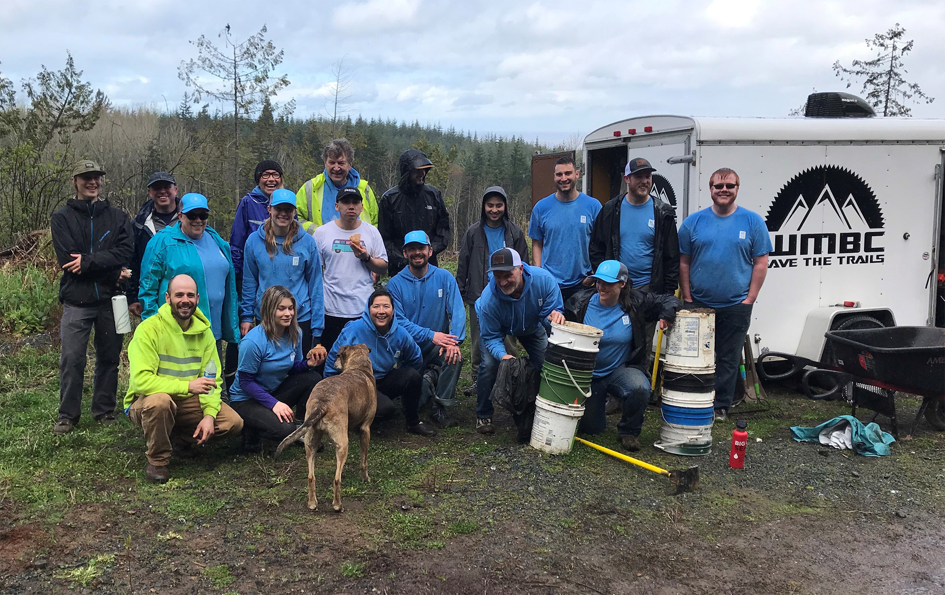 Team WECU Volunteers helping clear the trail near the Family Fun Center in April 2019.