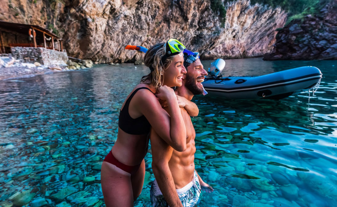 Woman and man snorkeling